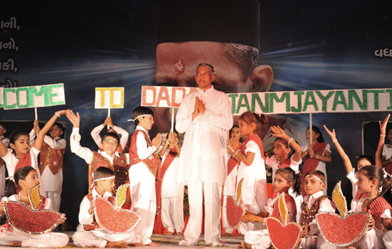 Pujyashree on stage with kids during inauguration
